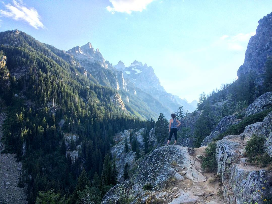 Hiker on a beautiful overlook in Grand Teton National Park