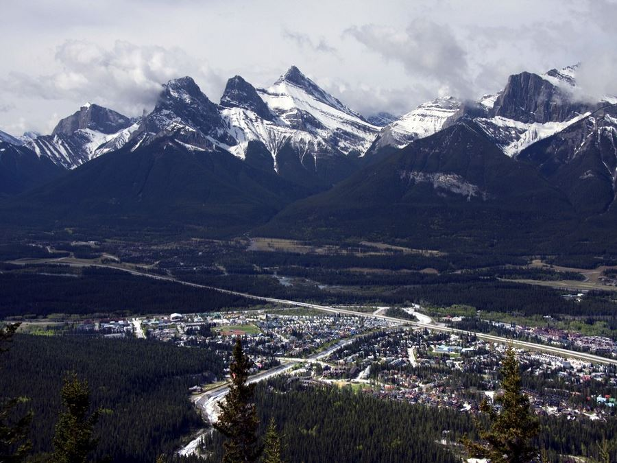 Three Sisters Mountain Range tower over Canmore
