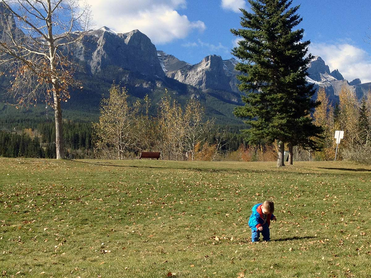 Playing in the park on the Main Street, Bow River and the Rail Bridge Hike in Canmore, Alberta