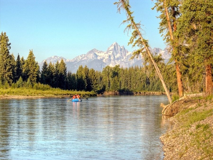 A group floats a raft down the Snake River