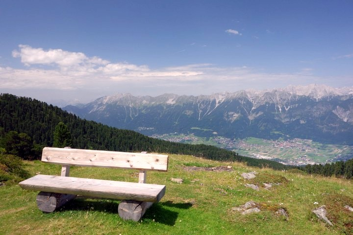 Bench on Zirbenweg trail to enjoy the view in Innsbruck