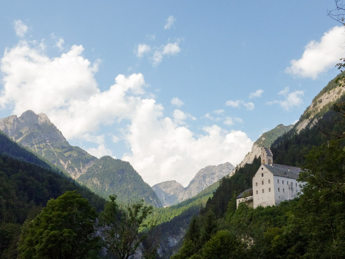 The monastery as seen from the forest on the Wolfsklamm Hike in Innsbruck, Austria