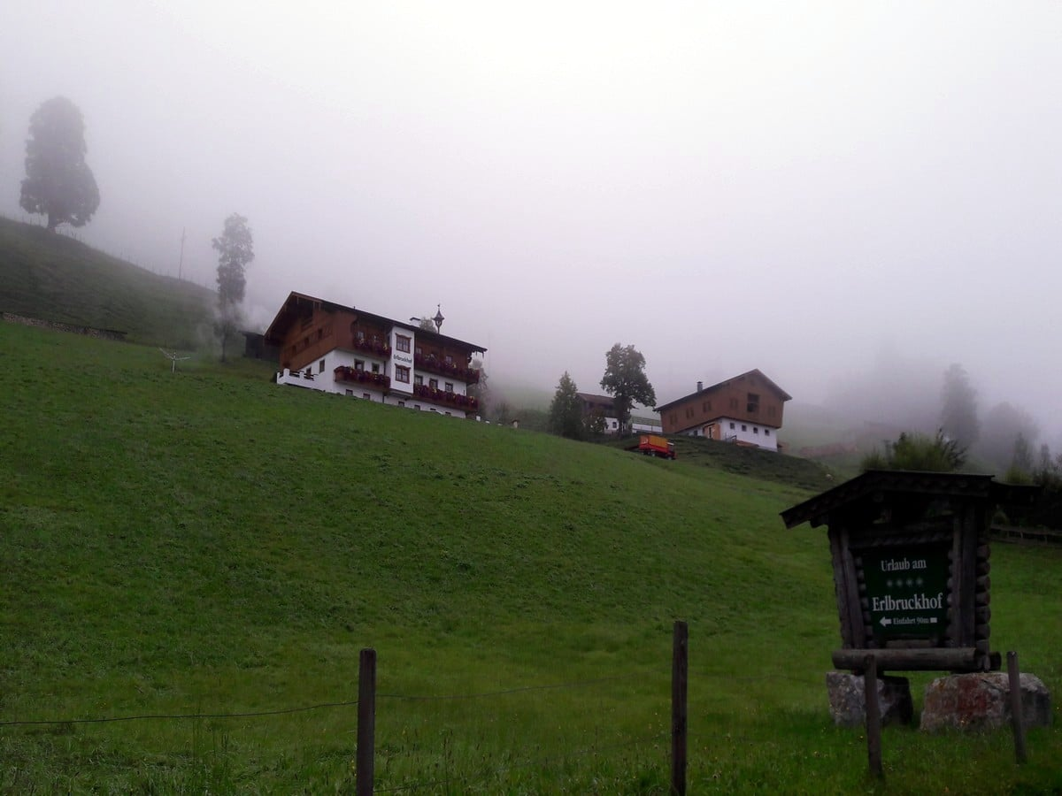 Traditional Austrian farm at the lake on the Zeller Lake Loop Hike in Zell am See - Kaprun, Austria