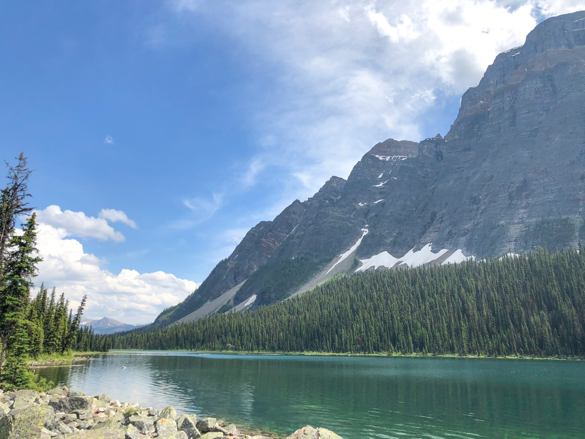 Beautiful peaks along the lake on the Boom Lake Hike near Banff, Alberta