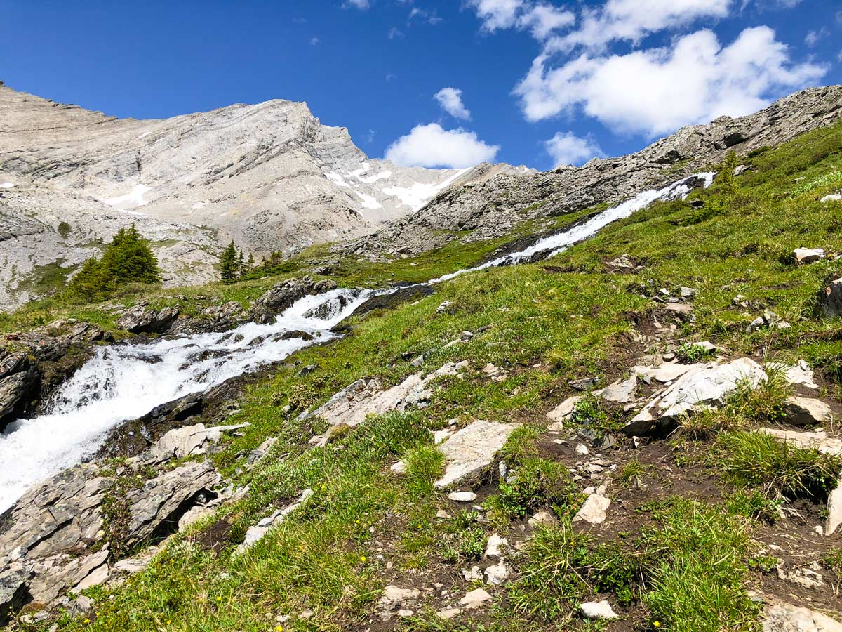 Trail beside the waterfall on the Headwall Lakes Hike near Smith-Dorrien Trail in Kananaskis, near Canmore