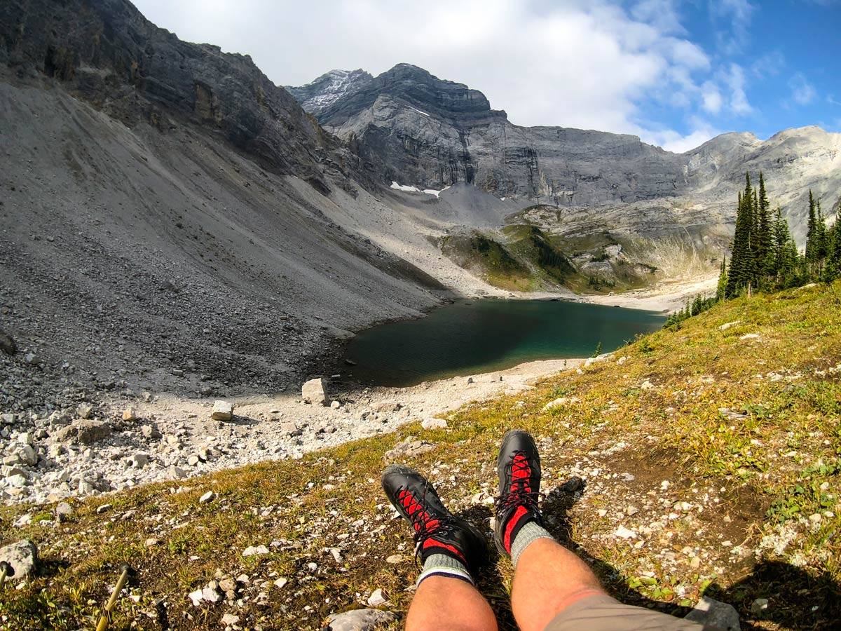 Hiker resting his feet on Lillian and Galatea Lakes Hike in Kananaskis, near Canmore
