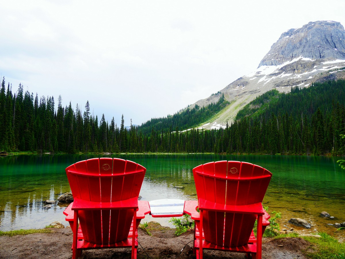 Red chairs on the Yoho Lake Hike in Yoho National Park, British Columbia