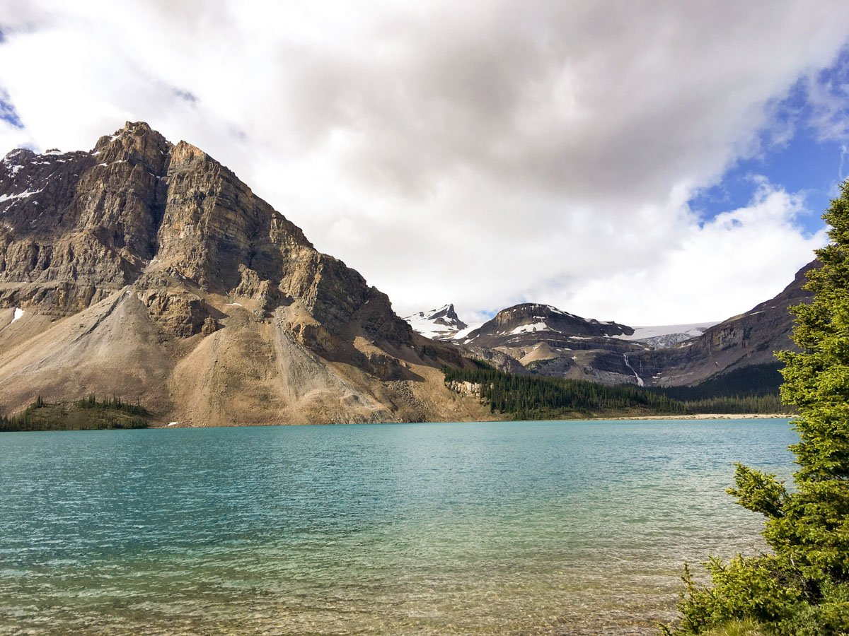 Walking along the lake on Bow Lake hike from Icefields Parkway, Alberta, Canada