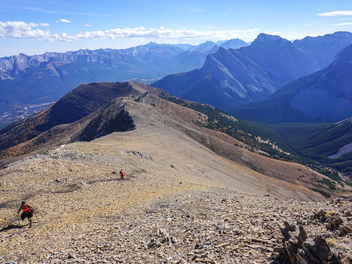 Hikers and mountains at Centennial Pass and Mount Allan Summit Hike in Canmore