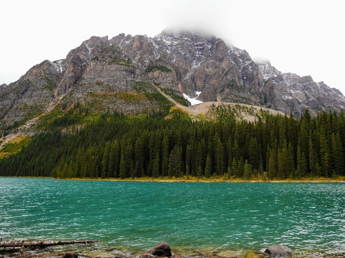 Mt Cephran's peak in the cloud above the lake on the Cirque & Chephren Lakes Hike from the Icefields Parkway near Banff National Park