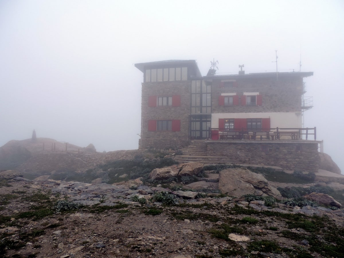 The hut in the fog on the Rifugio Remondino Hike in Alpi Marittime National Park, Italy