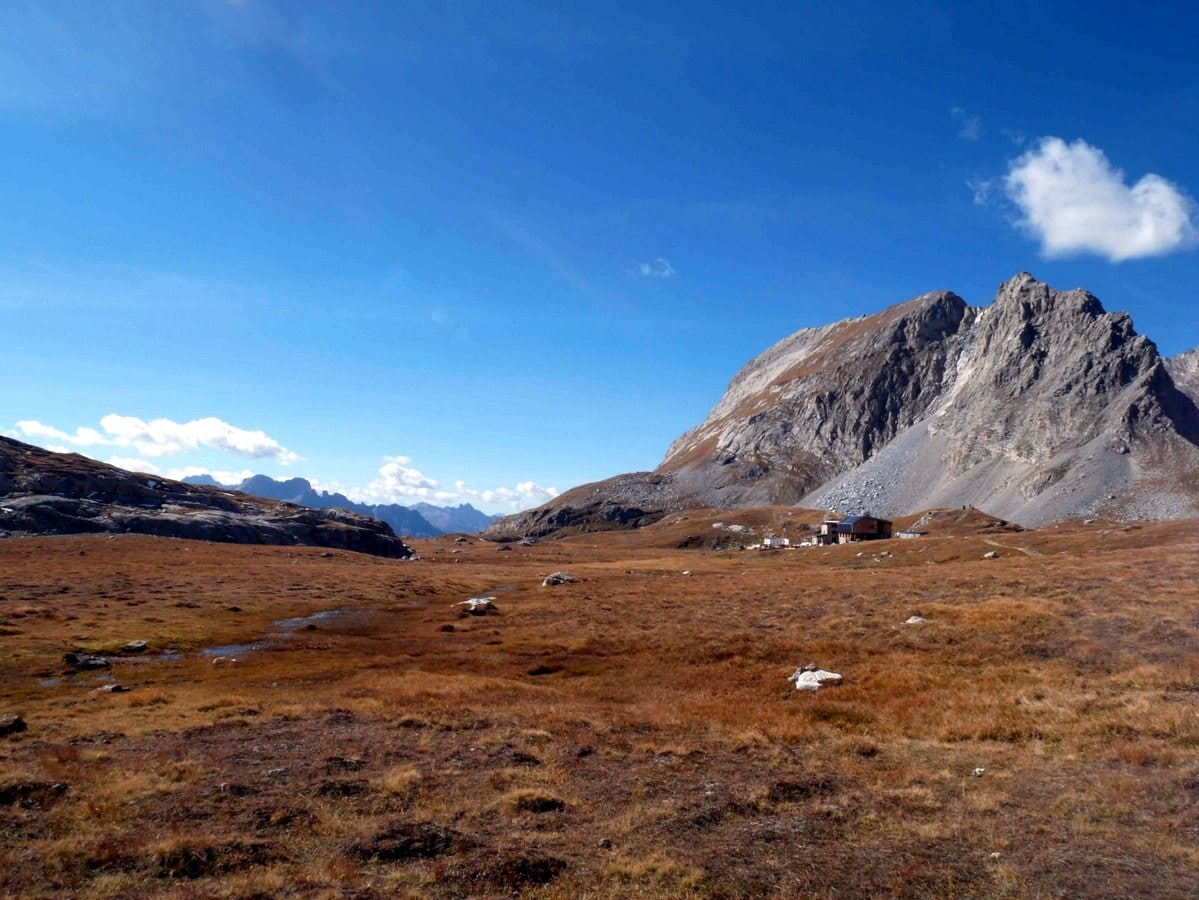 The refuge and the Aguille de la Vanoise on the Lac des Vaches and Col de la Vanoise Hike in Vanoise National Park in France