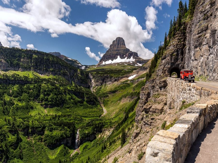 Beautiful view of Glacier National Park belong Going to the sun road with the iconic red car