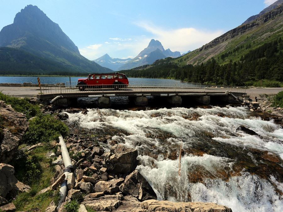 Red Tour Bus at Swiftcurrent Lake Glacier National Park