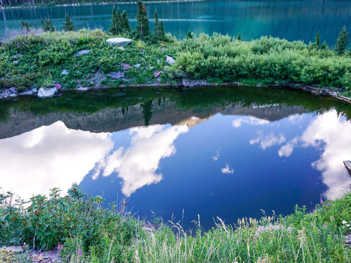 Reflections on the lake at Grinnell Glacier Hike in Glacier National Park
