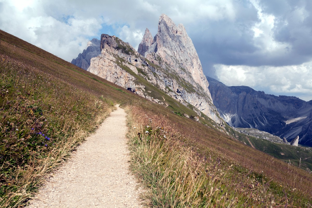 Trail of the Seceda / Puez Odle Hike descending from the top to the side of Odle in Dolomites, Italy