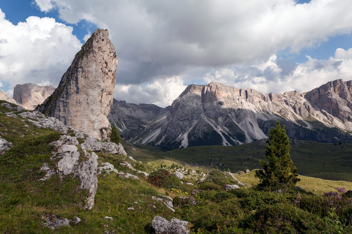 Characteristic rock formation with the Puez mountains on the background as seen from the Seceda / Puez Odle Hike in Dolomites, Italy