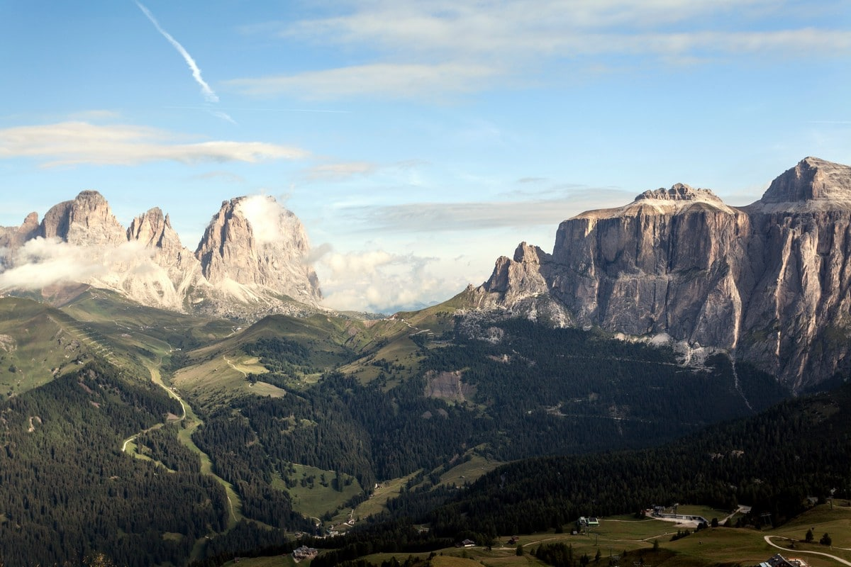 Sassolungo massif on the left, Sella Towers on the right as seen from the Viel del Pan Marmolada Hike in Dolomites, Italy