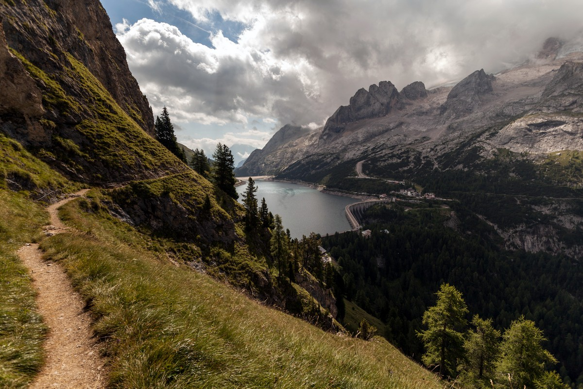 The path which leads to the Fedaia Lake on the Viel del Pan Marmolada Hike in Dolomites, Italy