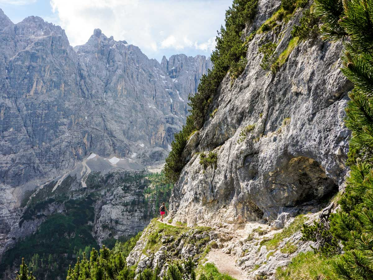 Narrow pathway with chains on the Lago di Sorapiss Hike in Dolomites, Italy
