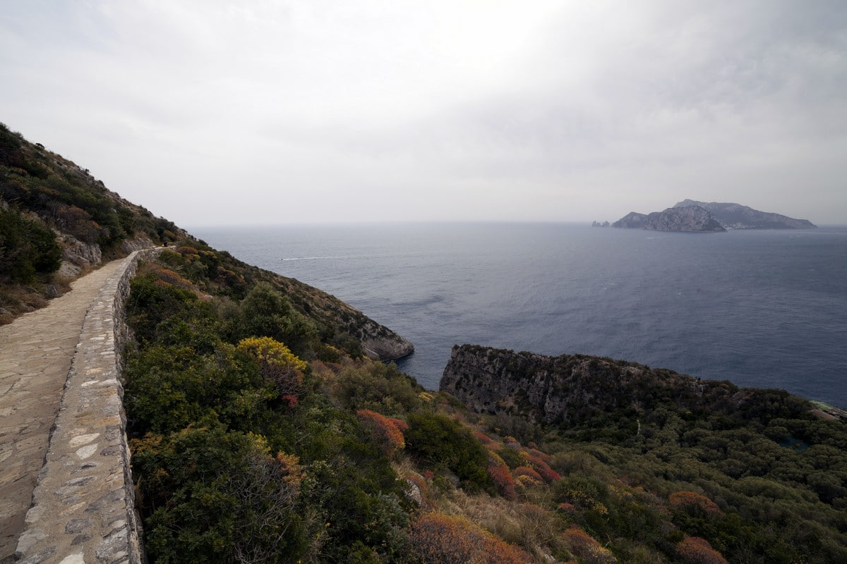 Capri and the trail of the Punta Campanella Hike in Amalfi Coast, Italy