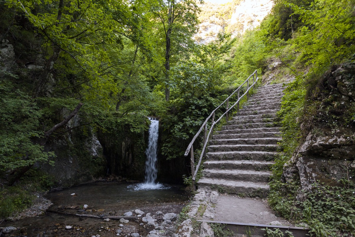 Stairs and one of the major falls of the Valle dei Mulini Hike in Amalfi Coast, Italy