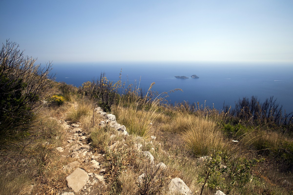 The trail and Li Galli archipelago from the Monte Comune Hike in Amalfi Coast, Italy