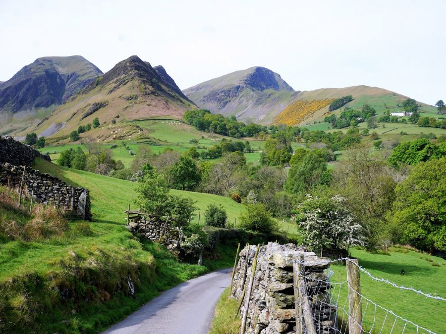 Walking out of Tiny Town towards Robinson on the Newlands Horseshoe Hike in Lake District, England