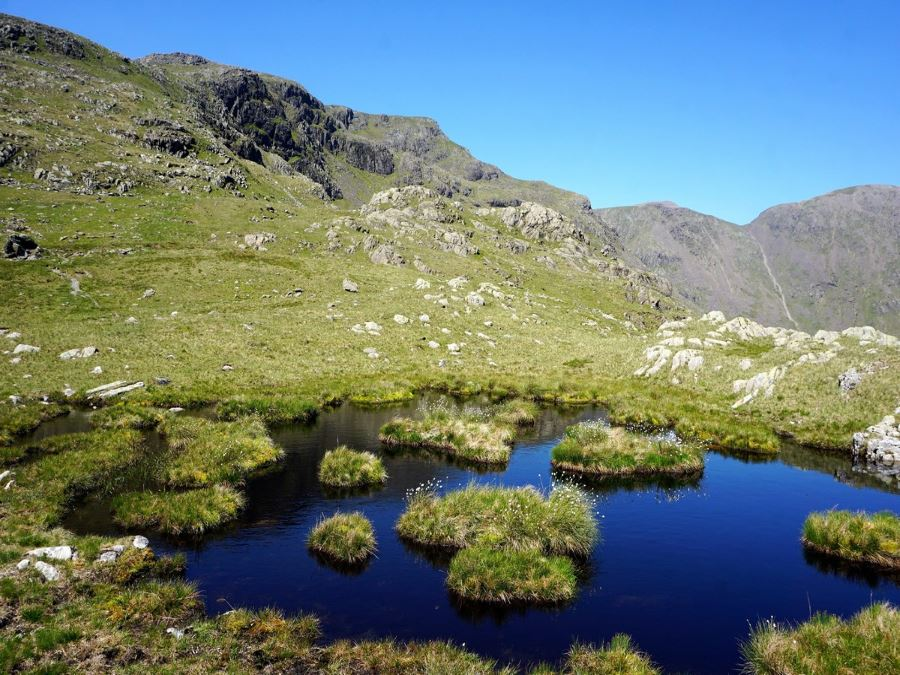 Small tarn near Red Pike from the Mosedale Horseshoe Hike in Lake District, England