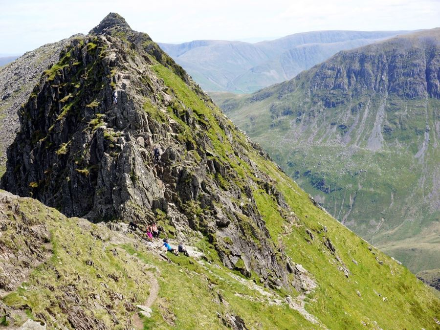 Climbing down from Striding Edge on the Helvellyn via Striding and Swirral Edge Hike in Lake District, England