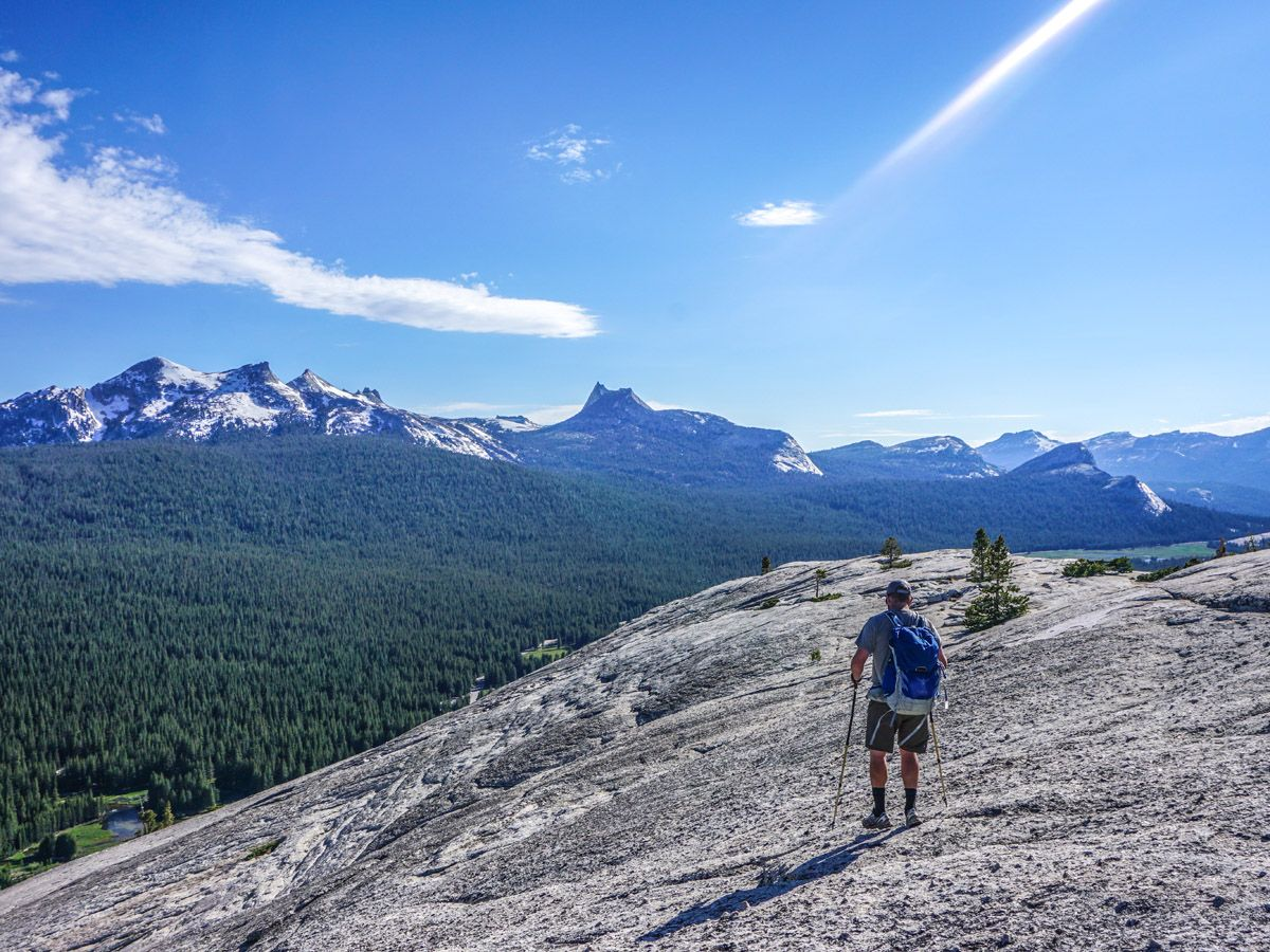 Man with hiking gear on the Lembert Dome Hike in Yosemite National Park, California