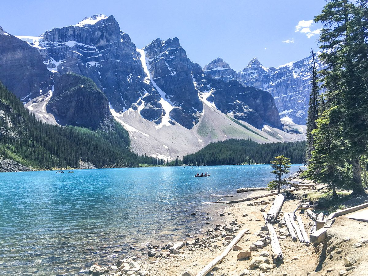 Blue lake surrounded by mountains on the Moraine Lake Rockpile and Lakeshore Hike in Lake Louise, Banff National Park