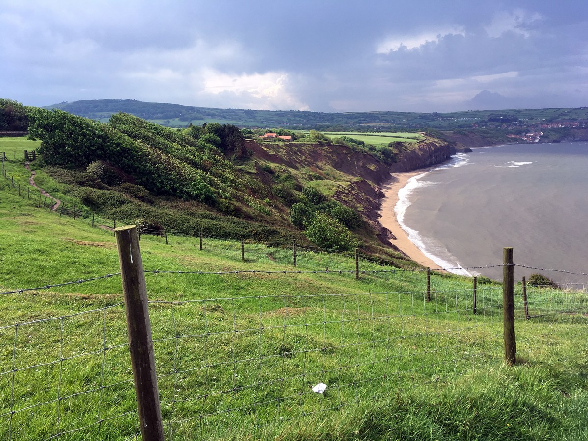 Cleveland Way down the beach on the Ravenscar and Robin Hood's Bay Hike in North York Moors, England