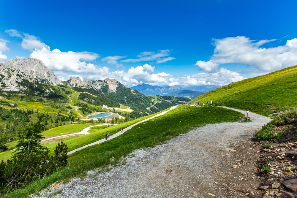 Hiking in Austrian Alps rewards with stunning panoramic views in summer