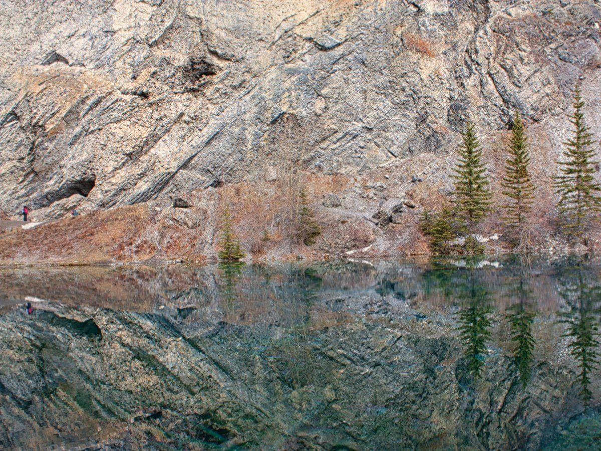 Reflections in the lake on the Grassi Lakes Circuit Hike in Canmore, the Canadian Rockies