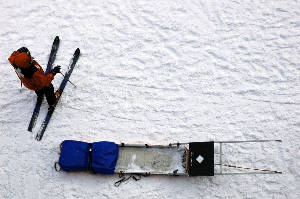 Mountain safety in winter includes ski patrol and sled