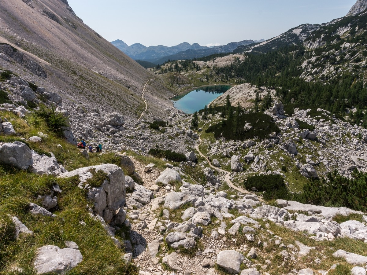 Descend to the Jezero v Ledvicah Kidney lake on the Valley of The Seven Lakes Hike in Julian Alps, Slovenia