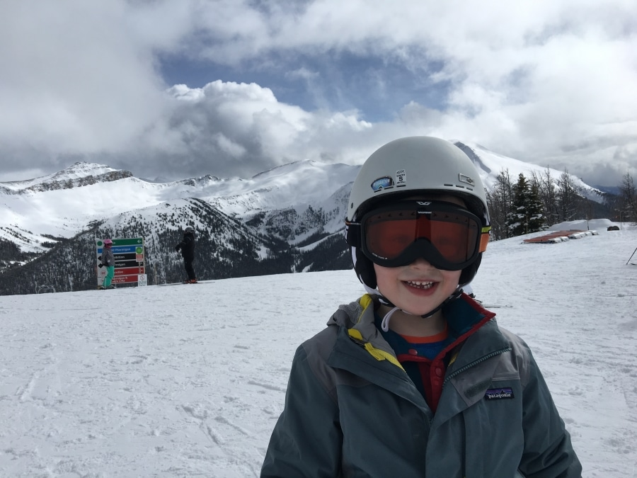 Happy kid on a family ski trip