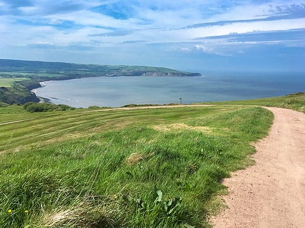 Trail of the Ravenscar and Robin Hood's Bay walk in North York Moors, England