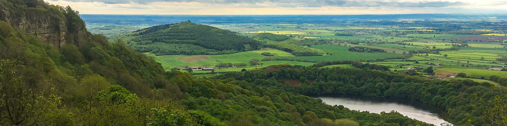 Panoramic views from the Sutton Bank, White Horse of Kilburn and Gormire Lake walk in North York Moors, England