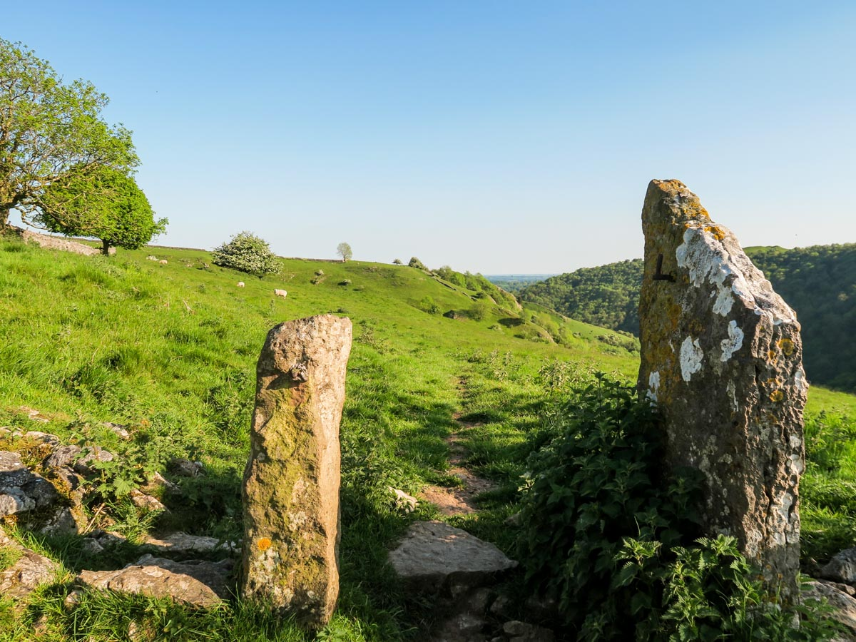 Millstone pillars on the high path of the Dovedale Circular Hike in Peak District, England