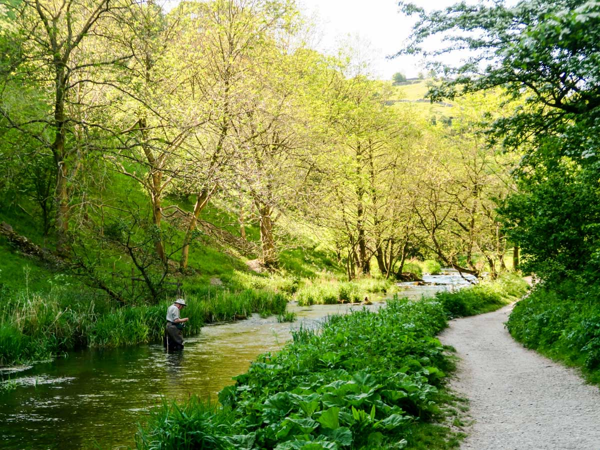 Flyfisher fishing along the Dovedale Circular Hike in Peak District, England