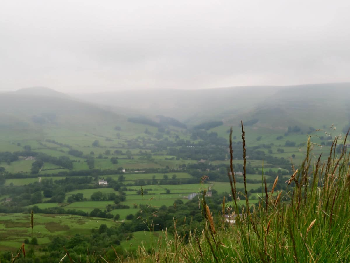 Edale hiding in the valley mist on the Great Ridge and Win Hill Hike in Peak District, England