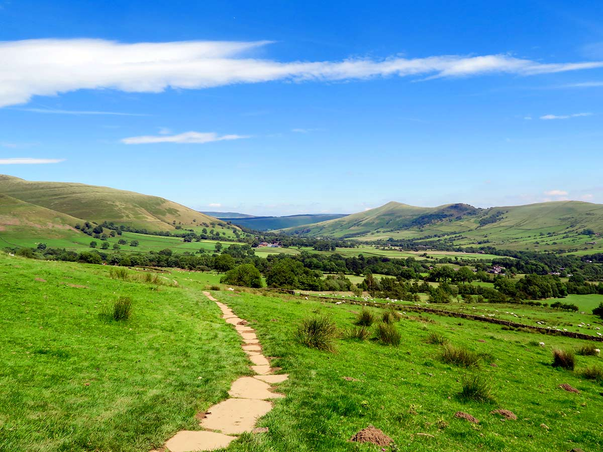The Vale of Edale Hope Valley ridge in the background on the Kinder Scout Hike in Peak District, England