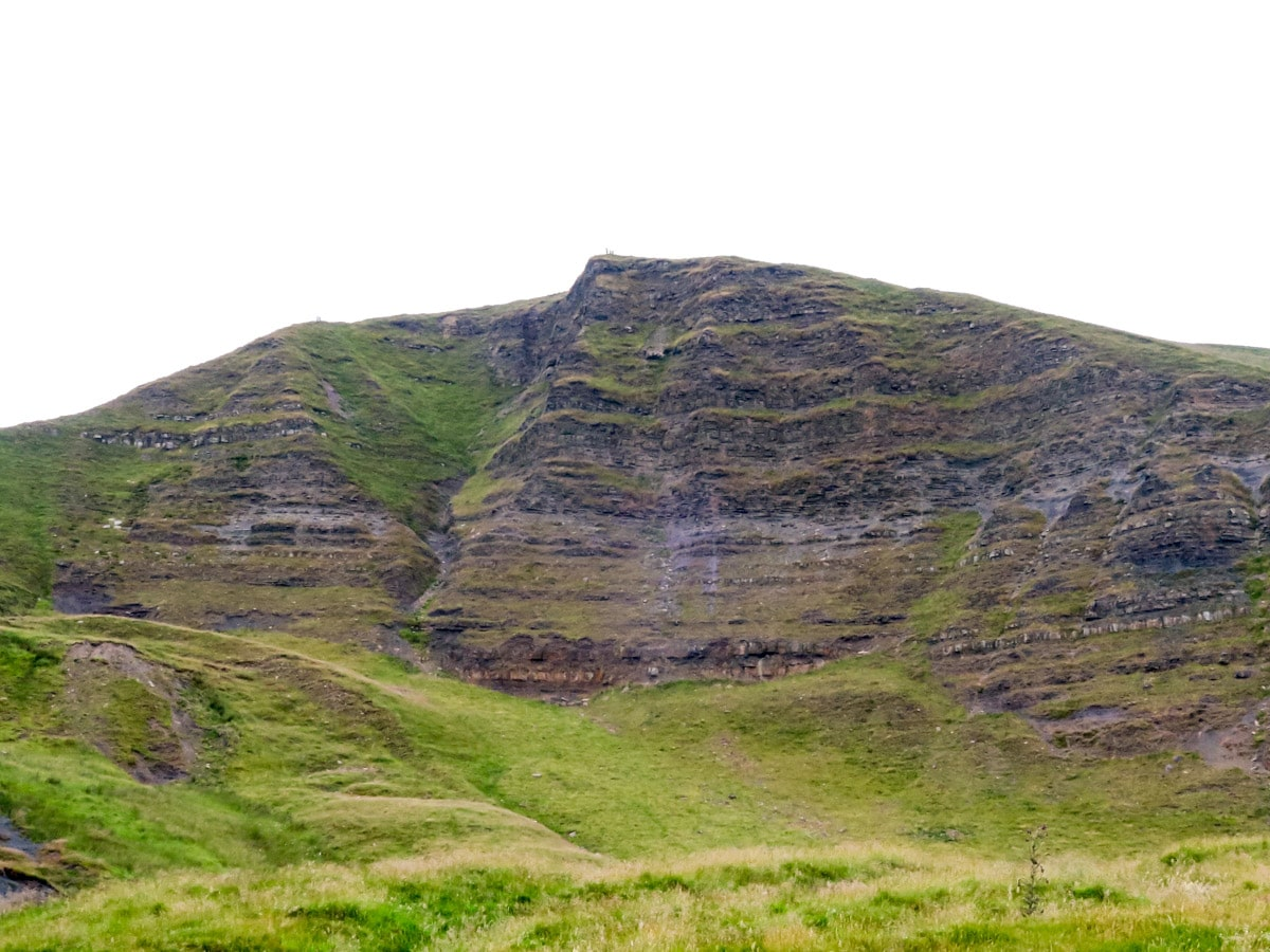 The steep cliff of south face of Mam Tor Peak on Mam Tor Circular Hike in Peak District, England