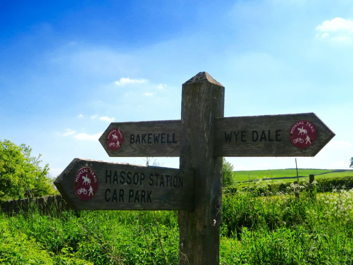 Trail signpost on the Monsal Trail Hike in Peak District, England