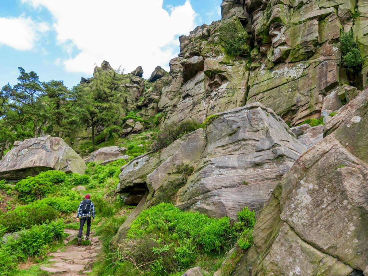 Beneath the crags on The Roaches and Lud's Church Hike in Peak District, England