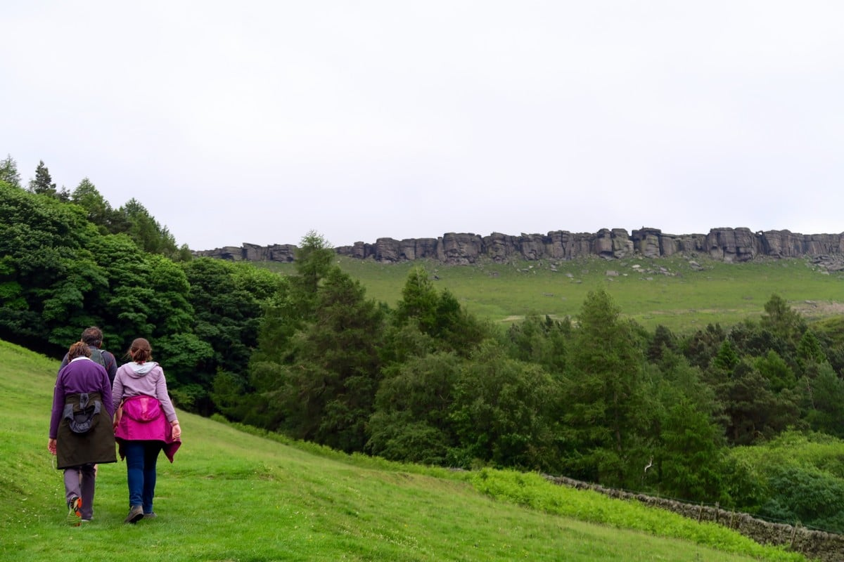 Walking towards Stanage Plantation on the Stanage Edge from Hathersage Hike in Peak District, England