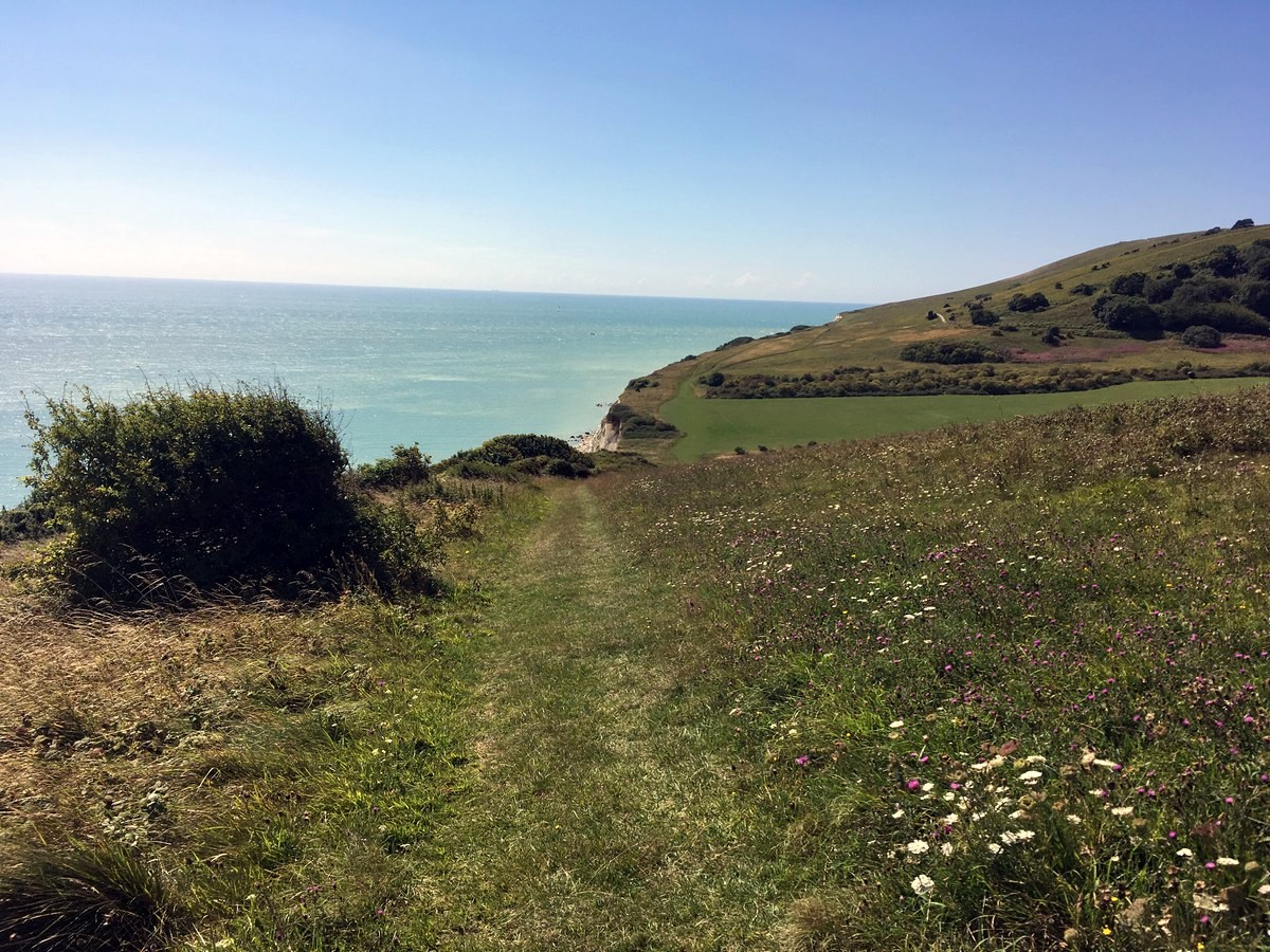 The trail into Whitebread hole on the East Dean, Beachy Head and Birling Gap Hike in South Downs, England