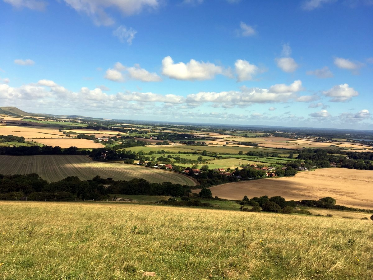 View across Cuckmere valley from the Long Man of Wilmington to Alfriston Hike in South Downs, England